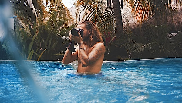 Man with long hair in a pool