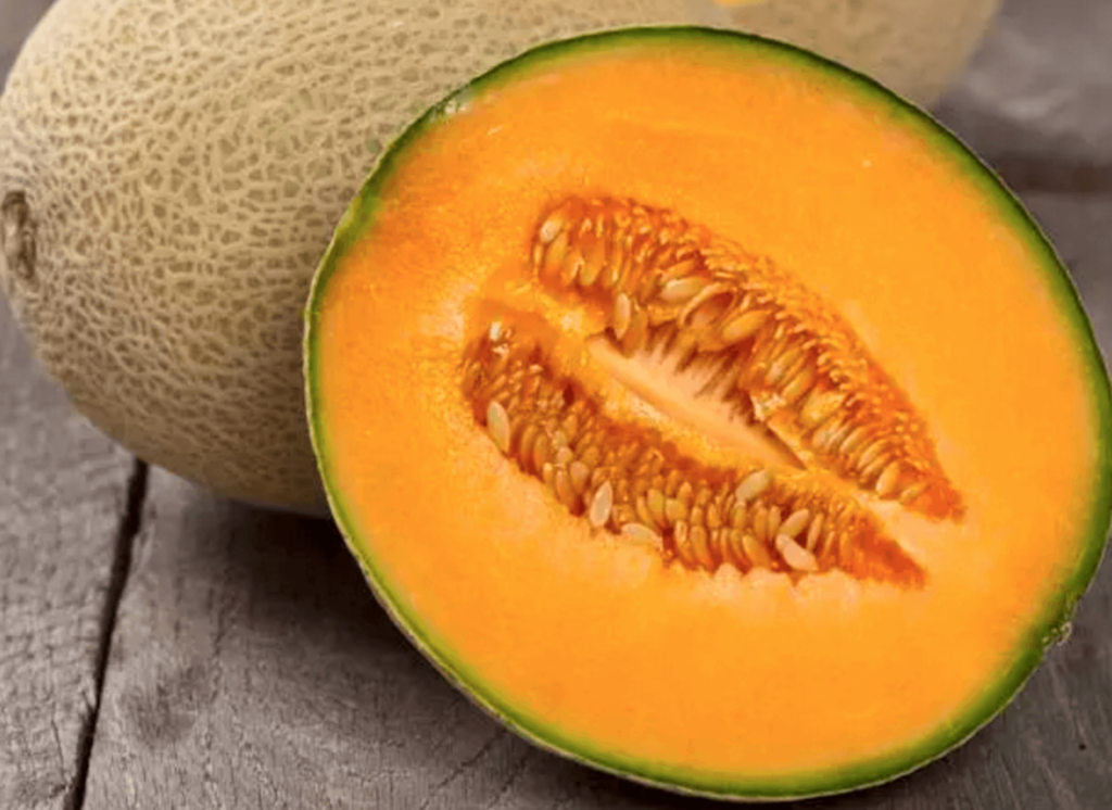 sliced cantaloupe on a wooden surface