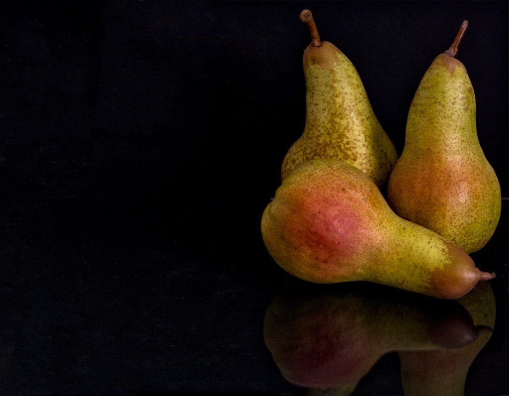 3 pears on a black background