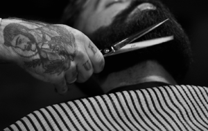 Man getting his beard trimmed at a barber shop