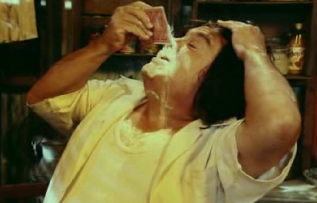 Frank Reynolds pouring cocaine into his nose.
