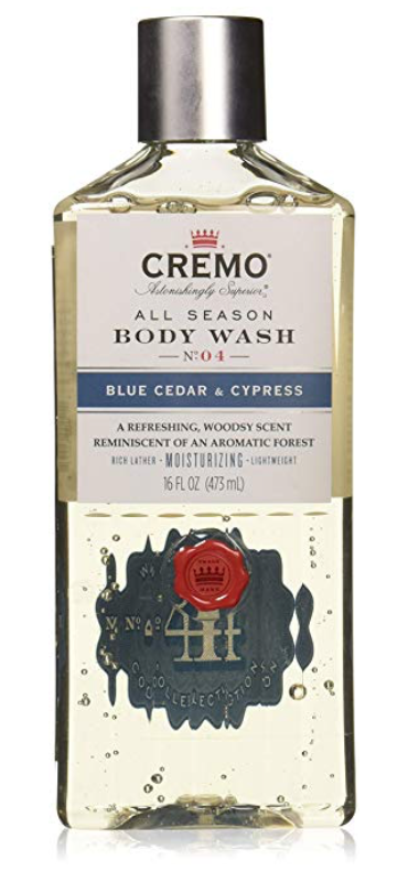 Bottle of Cremo blue cedar and cyprus body wash for men