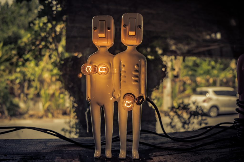 male and female statues with lightbulb genitals. Awkward.