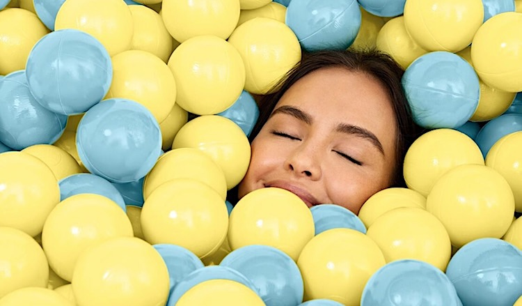 Women basking in a ball pit