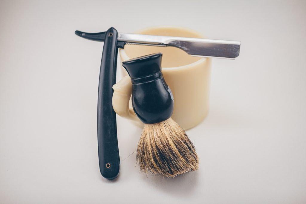 A straight edge razor, brush, and bowl