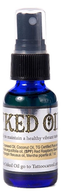 Bottle of Inked Oil tattoo brightener