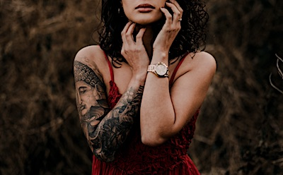 Women in red dress with a sleeve tattoo