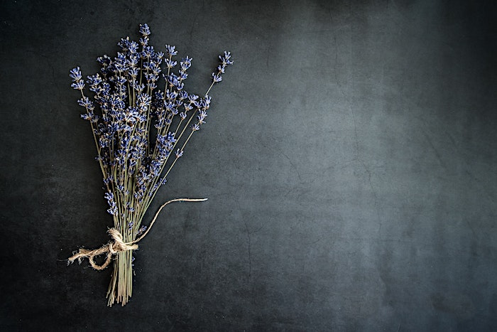 Lavender sprigs laying on a table