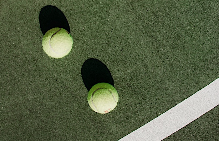 two tennis balls on a court