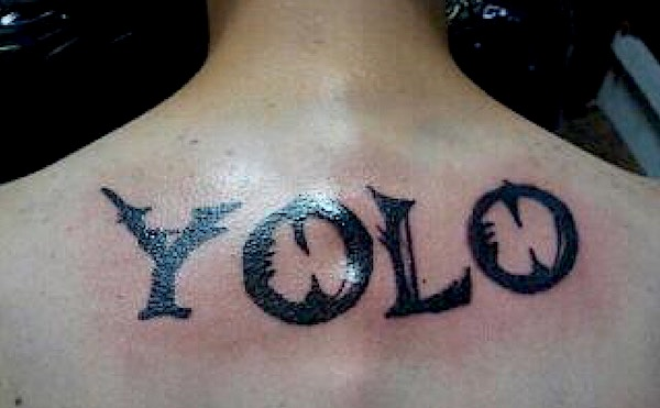 YOLO tattoo on a guys back