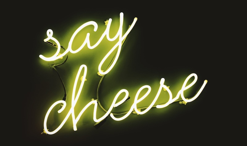 """Neon sign that says """"Say Cheese"""""""