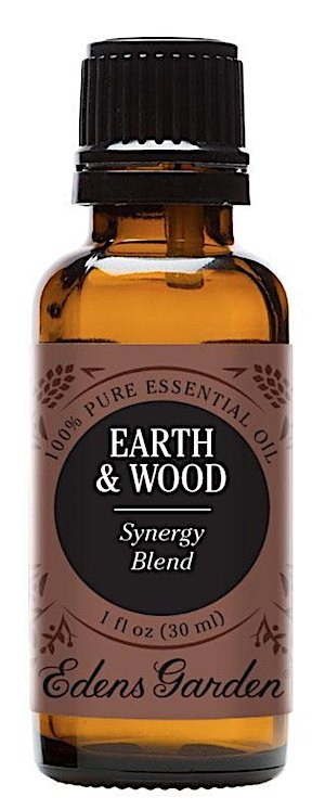 A bottle of Earth & Wood essential oil blend from Edens Garden.